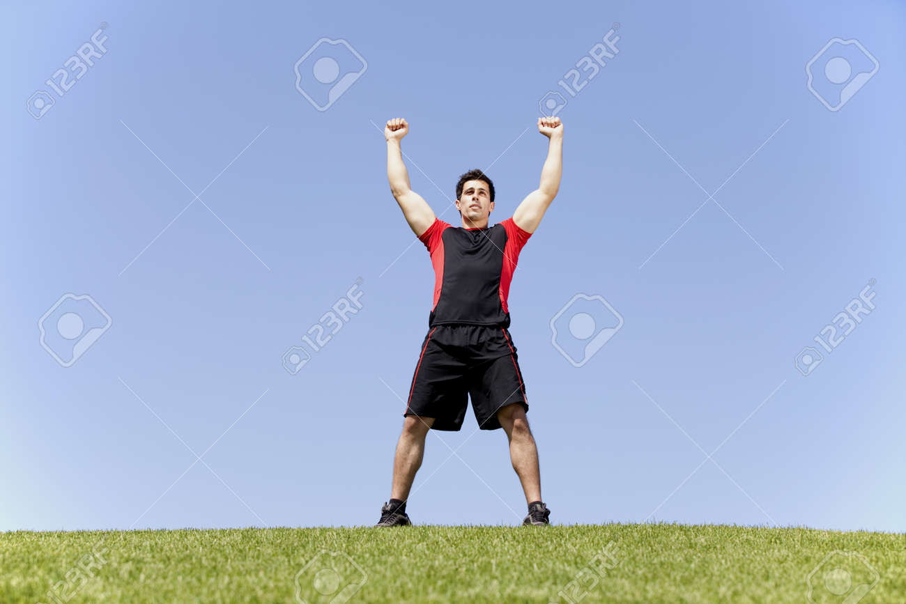 Athlete enjoying his victory at the top of a hill Stock Photo - 10035680