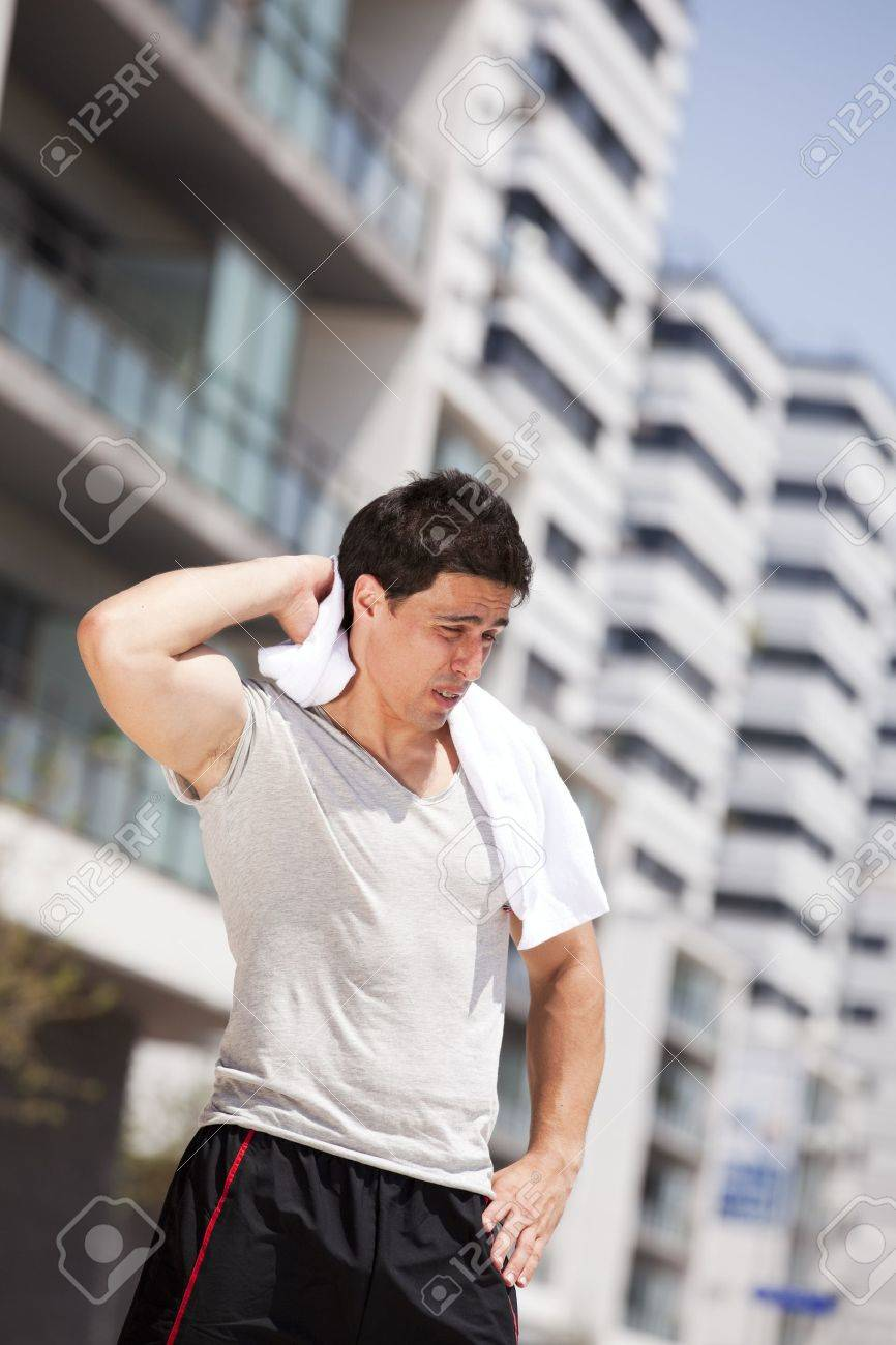 Athlete man tired after a long running sport event in the city Stock Photo - 10035803