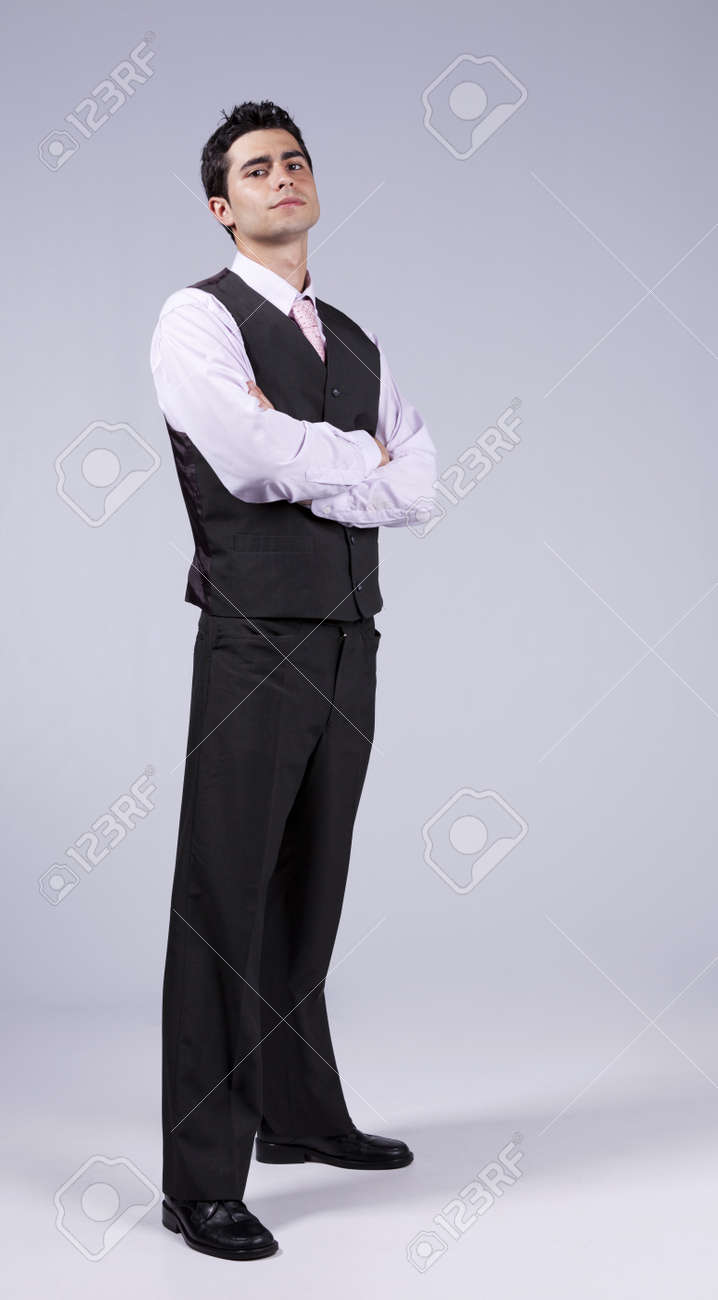 Powerful Young Businessman With His Arms Crossed Isolated On