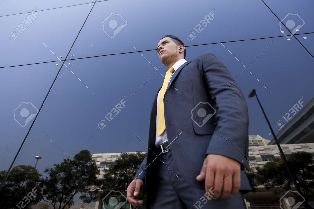 Confident young businessman next to his office building Stock Photo - 16388989