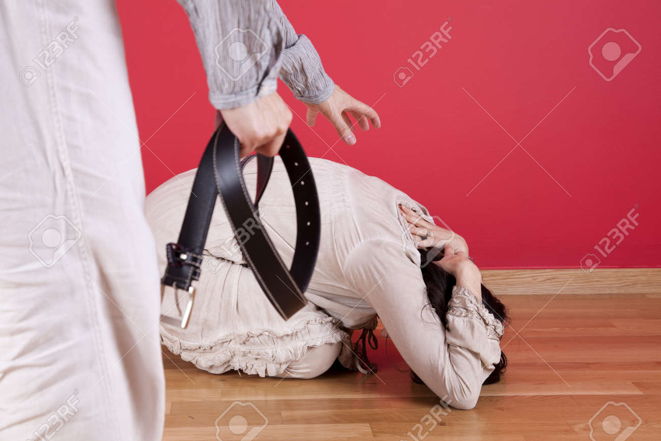 Men threating and beating his wife at home with a belt Stock Photo - 16389044