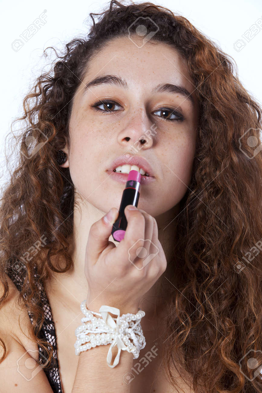 Sensual young woman applying lipstick (isolated on gray) Stock Photo - 16389270