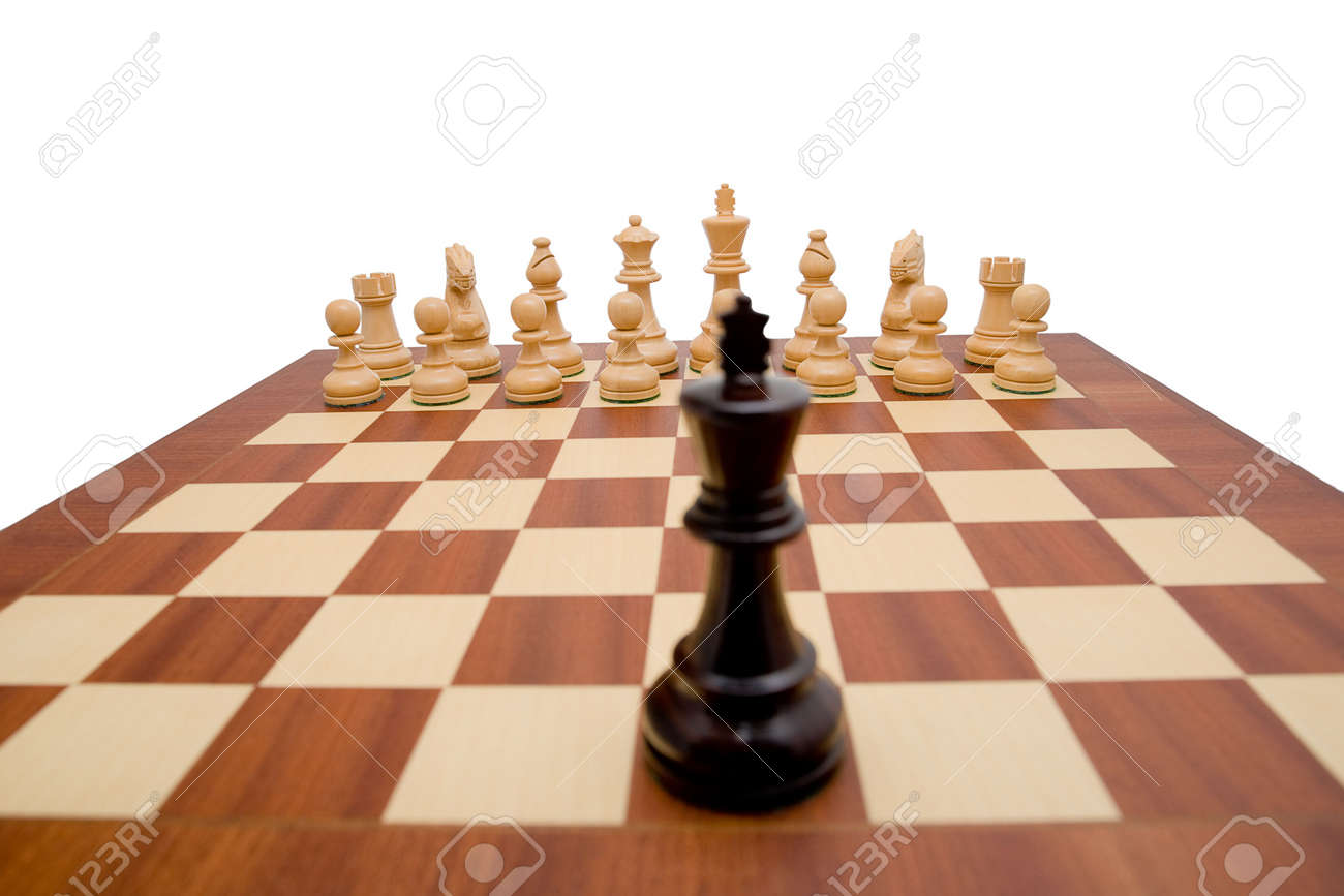 King looking down the chess board at the opposing pieces. Stock Photo - 2673675