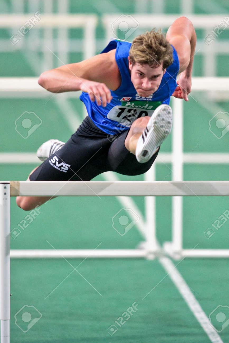 VIENNA, AUSTRIA - FEBRUARY 21: Indoor track and field championship: Manuel Prazak wins the men's 60m hurdle event February 21, 2009 in Vienna, Austria. Stock Photo - 8194588