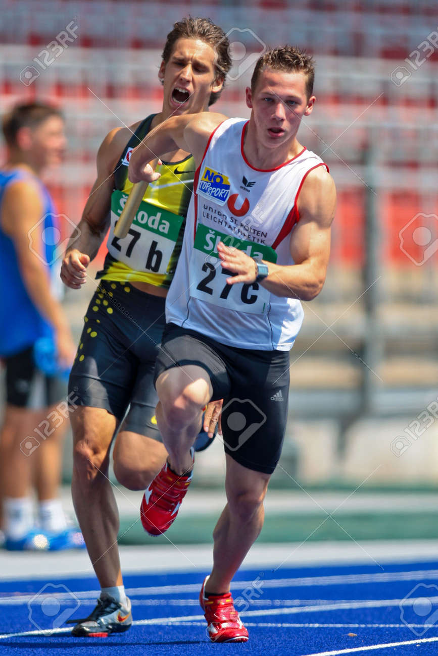 LINZ, AUSTRIA - AUGUST 2 Austrian track and field championship: Benjamin Grill (back) and Norbert Schrott (front) place fourth in the men's 4x100m relay on August 2, 2009 in Linz, Austria. Stock Photo - 8448759