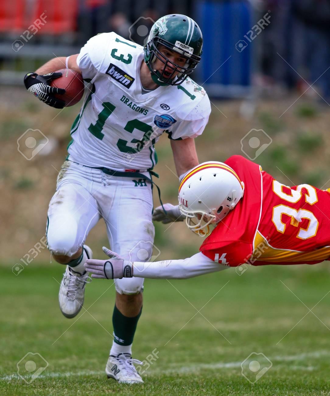 KORNEUBURG, AUSTRIA - APRIL 10 Danube Dragons beat St. Poelten Invaders in an AFL-season game 63-55 on April 10, 2010. Shown is WR Thomas Haider (Dragons #13). Stock Photo - 8465286