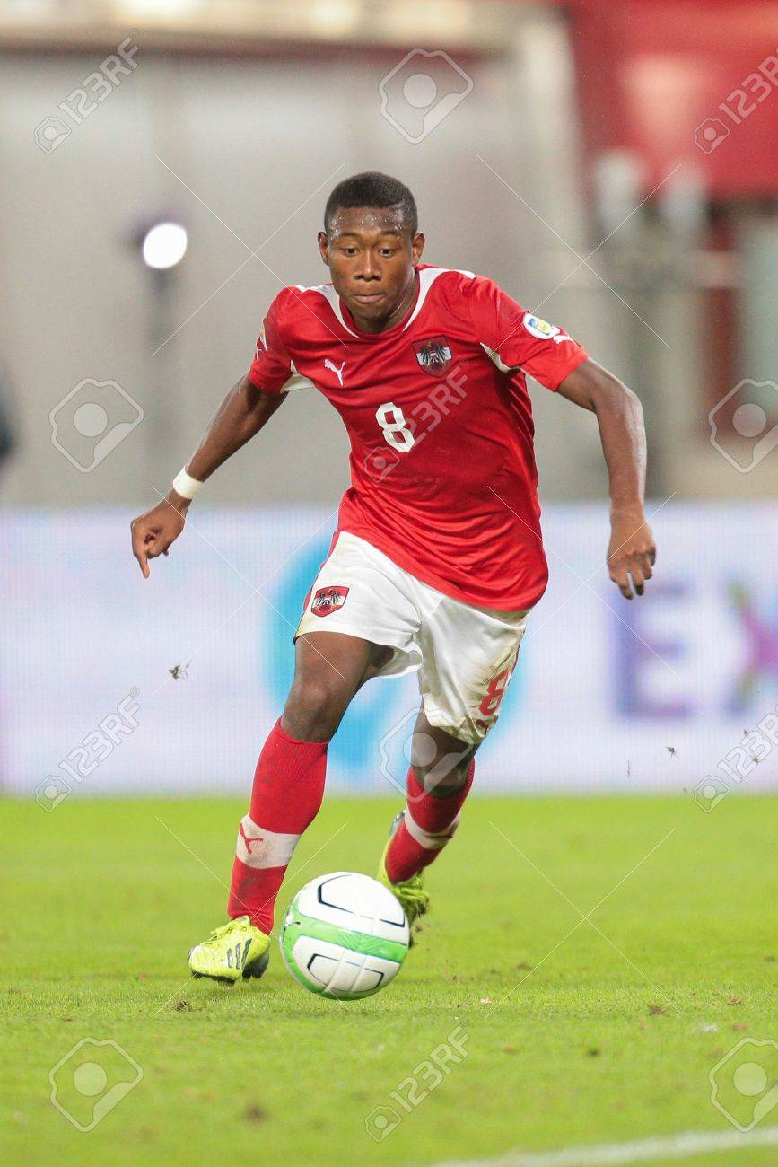 Stock Photo - VIENNA, AUSTRIA - SEPTEMBER 10 David Alaba (#8 Austria) runs  with the ball at a World Cup Qualifying game on September 10, 2013 in  Vienna, ...