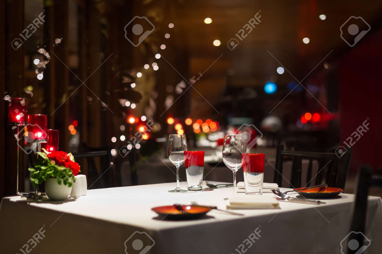 romantic dinner setup, red decoration with candle light in a