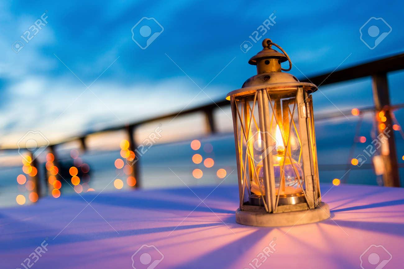 Lantern on table at twilight sky, selective focus. - 47293910