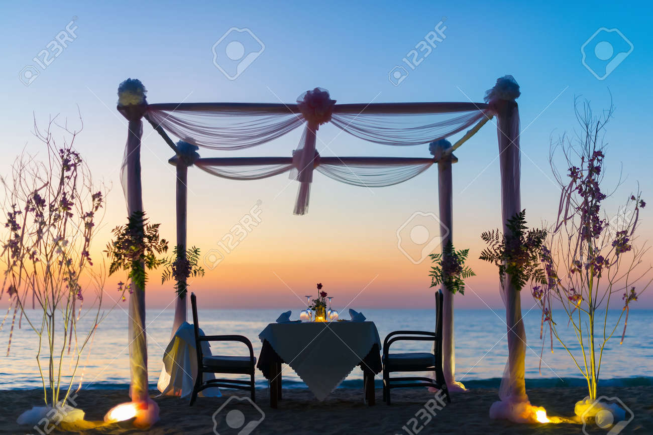 Romantic dinner setting on the beach at sunset. - 54465046