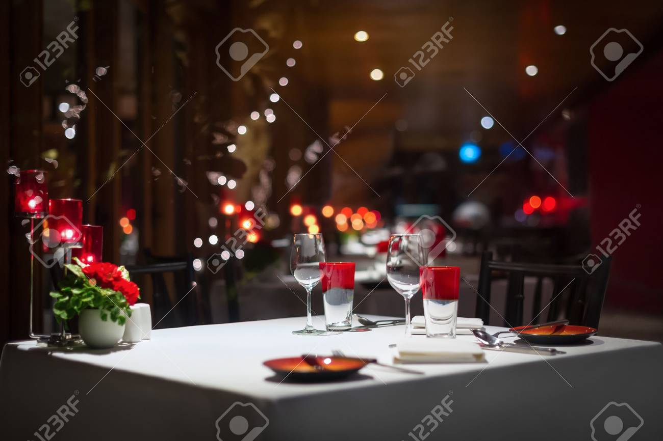 dinner table setting red decoration with candle light in a restaurant. Selective focus. & Dinner Table Setting Red Decoration With Candle Light In A ...