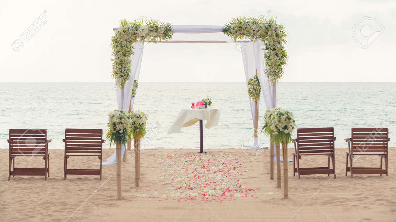 Simple Style Wedding Arch And Decoration Venue Setup On Tropical Beach Outdoor