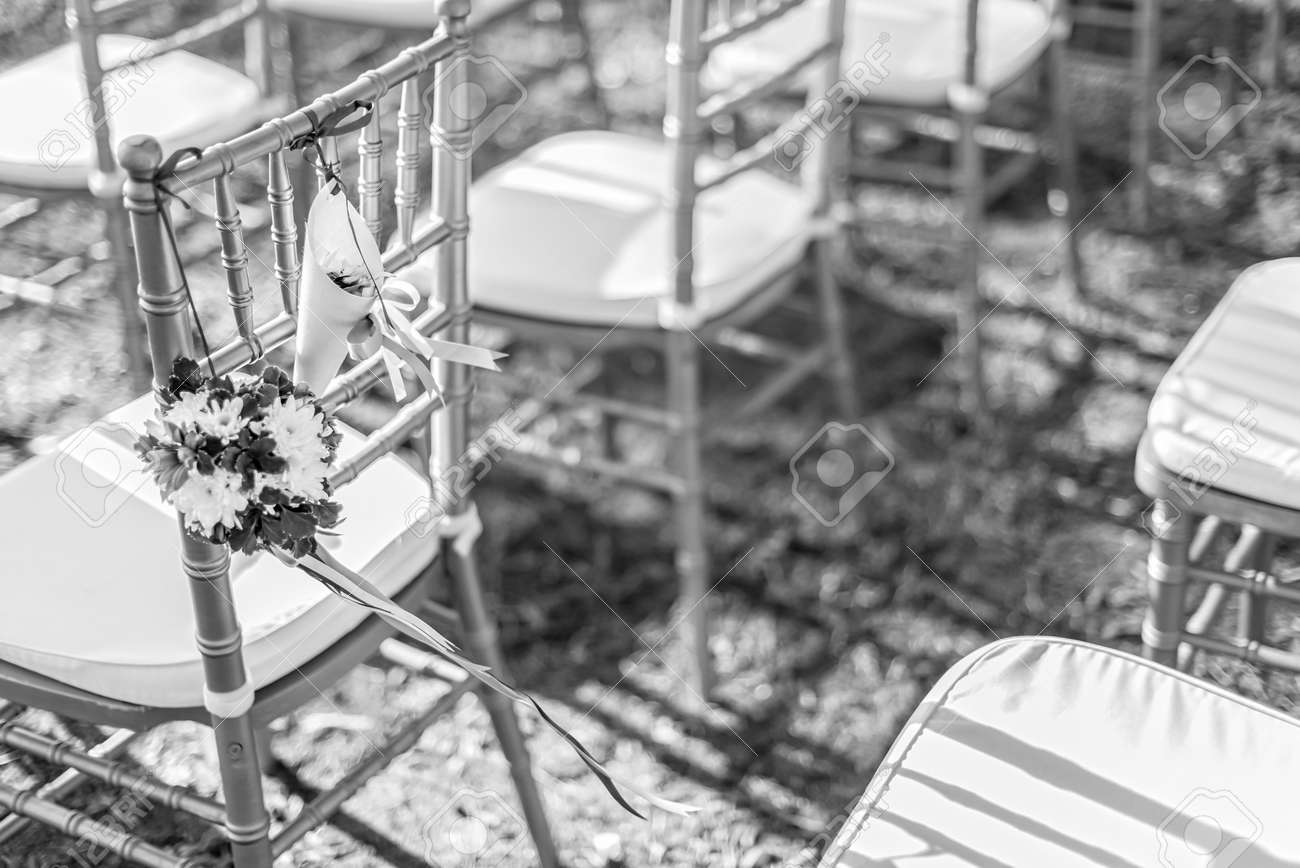 Wedding Decorations And Arrangement Flowers Chairs Ribbon Stock