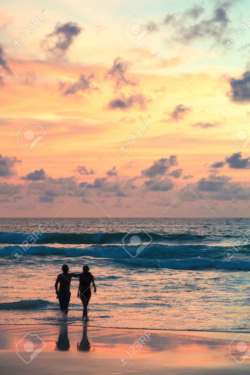 Seascape Beautiful Sunset Beach With Silhouette Couples Walking