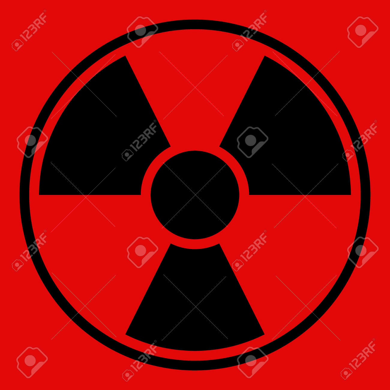 Round radiation warning sign on red background Stock Photo - 7555902