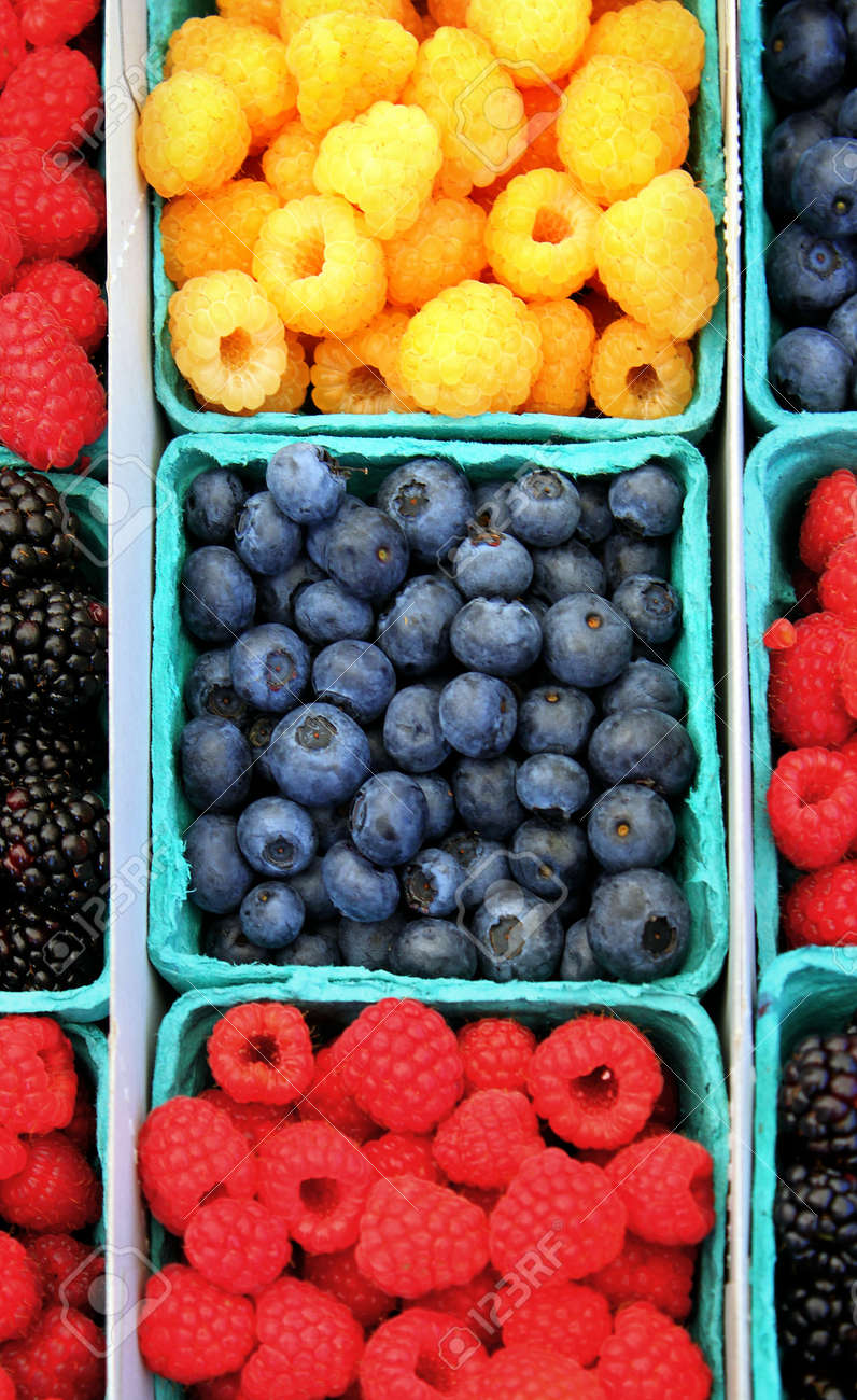Yellow and red rasberries with blueberries. Stock Photo - 12340121