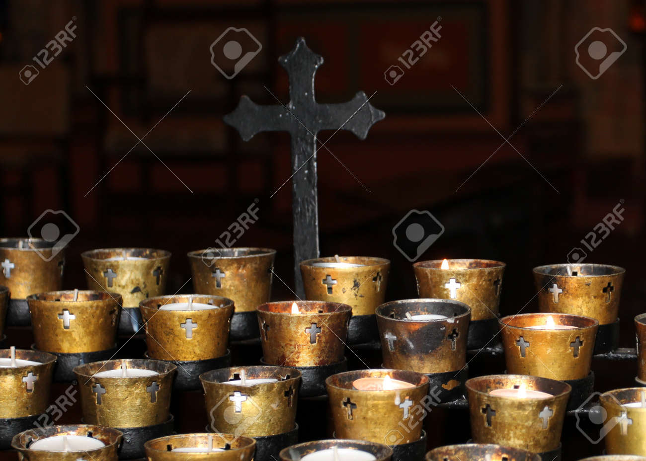 Candles in a church on black background with a cross Stock Photo - 17014256