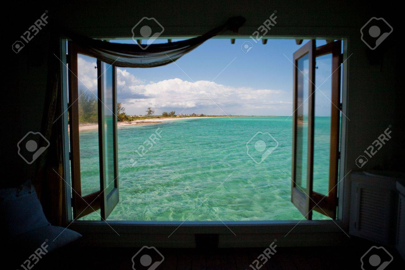 Windows opened with a veiw of the Caribbean Sea Stock Photo - 4633208