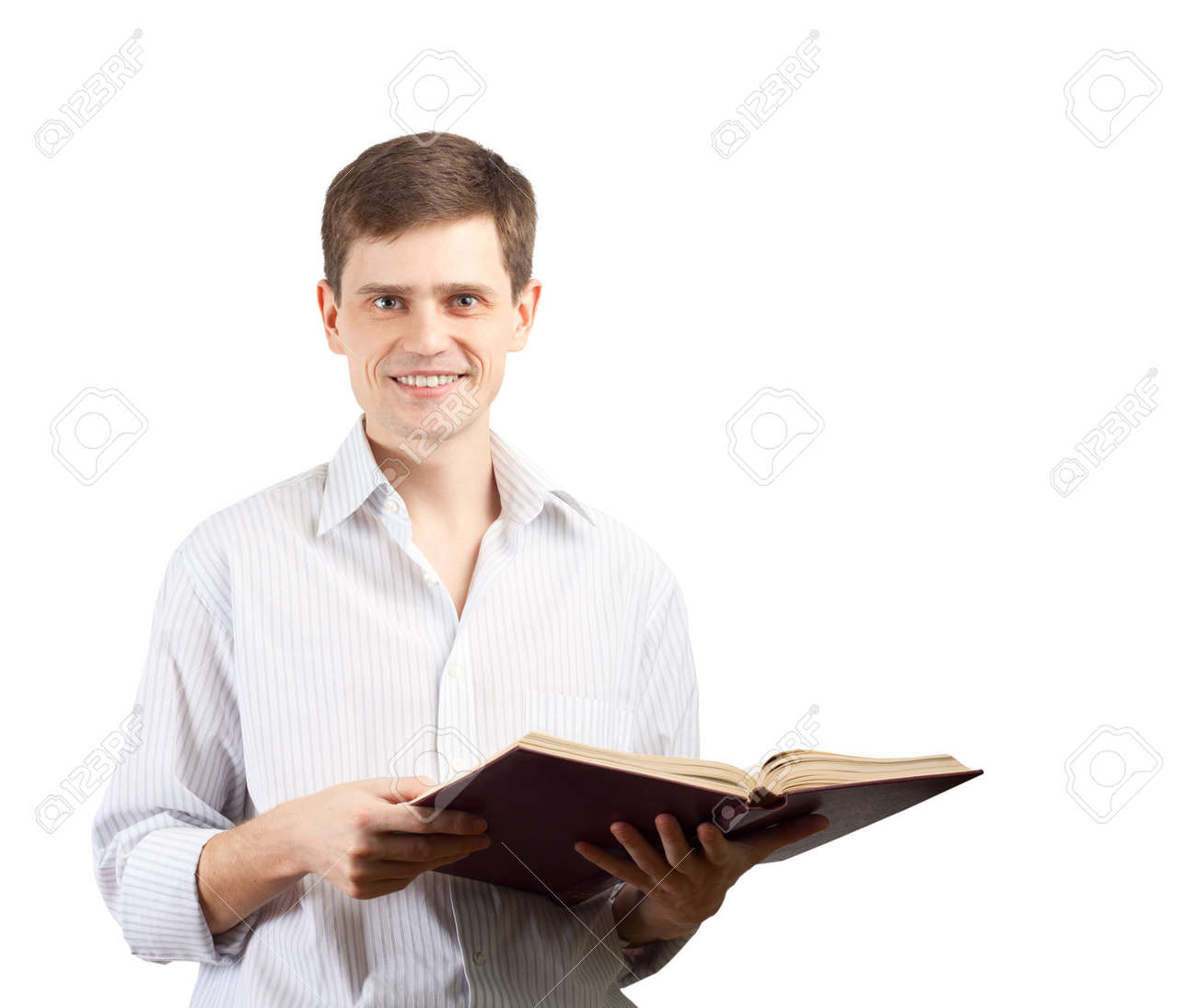 Smiling man with open book over white background. Stock Photo - 9467827