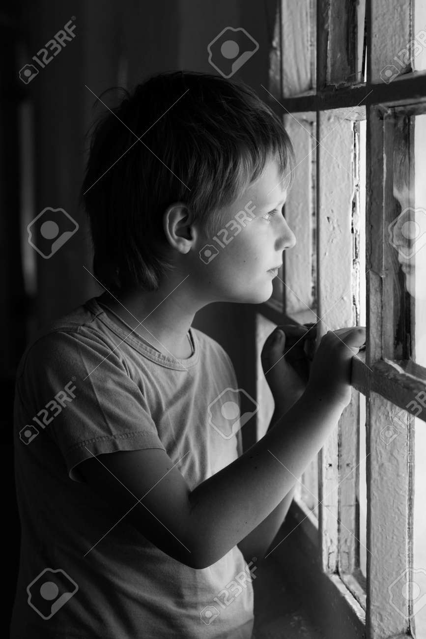 Sad Boy Looking In Window Black And White Stock Photo Picture And Royalty Free Image Image 11490428