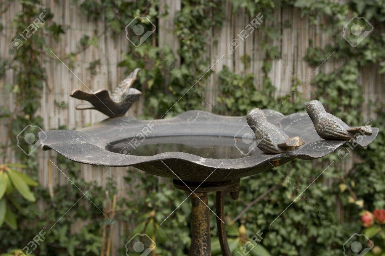 Bronze Birdbath In Garden With Bronze Birds And Water Stock Photo   2657794