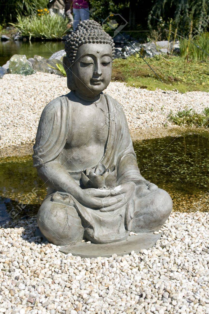 Sitting Buddha With Lotus Flower In Hands Stock Photo Picture And