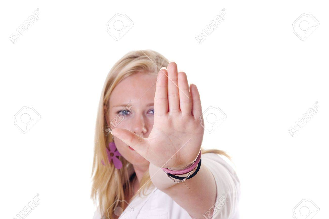 Girl holding hand up saying stop. Face visible Stock Photo - 5470809