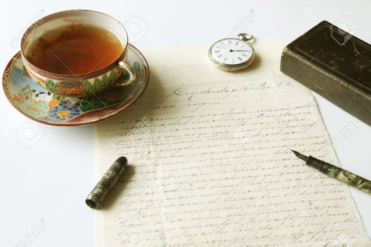 Vintage scene of old handwritten letter, antique fountain pen, pocket watch, chinese porcelain tea cup filled with tea and lold eather pocket bible Stock Photo - 6491628