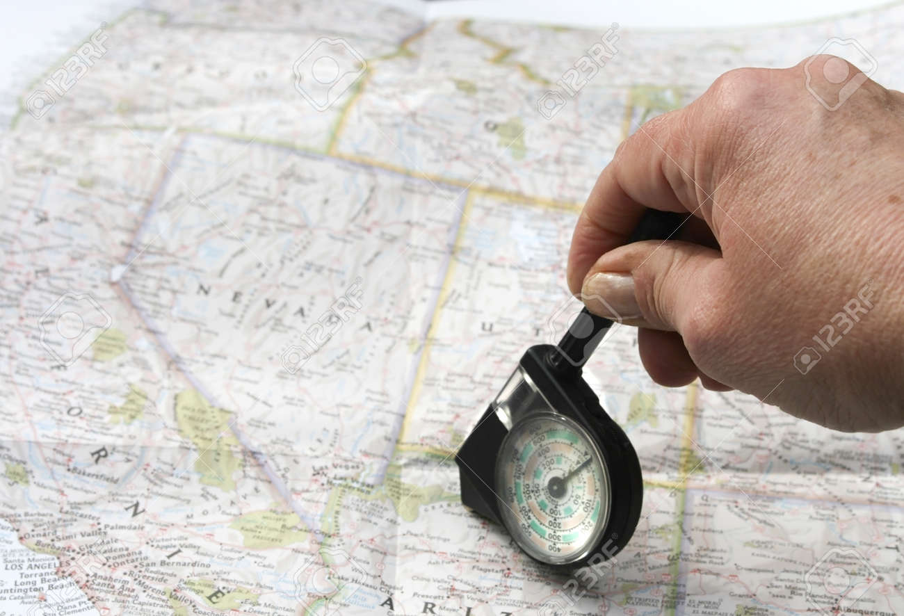 Hand With Distance Calculator On Route Map Of West Usa Stock Photo 7752843