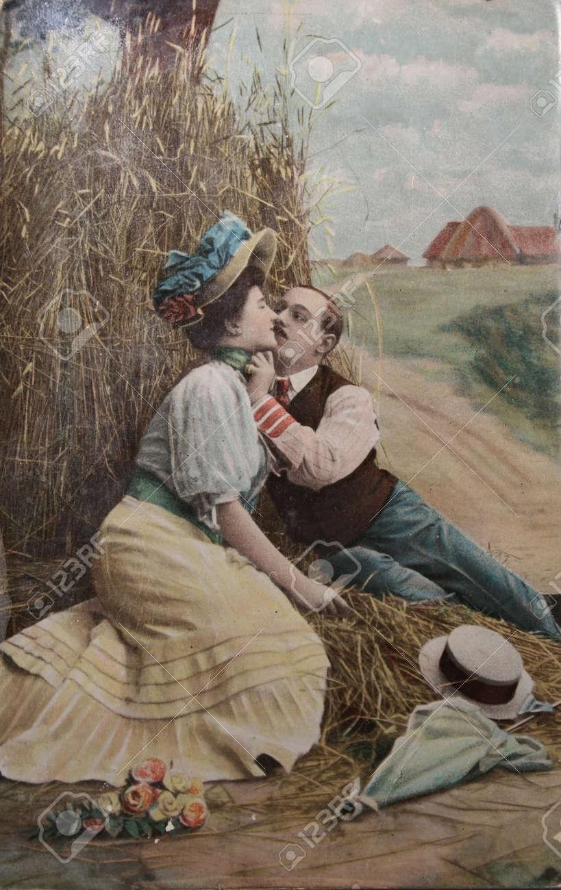 passionate love, couple kissing in haystack- circa 1904 postcard Stock Photo - 9158230
