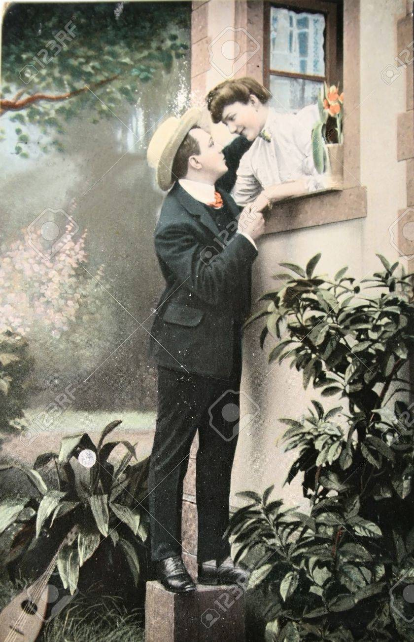 Victorian romance - loving couple  - circa 1907  hand-tinted photograph postcard,  Stock Photo - 9158228