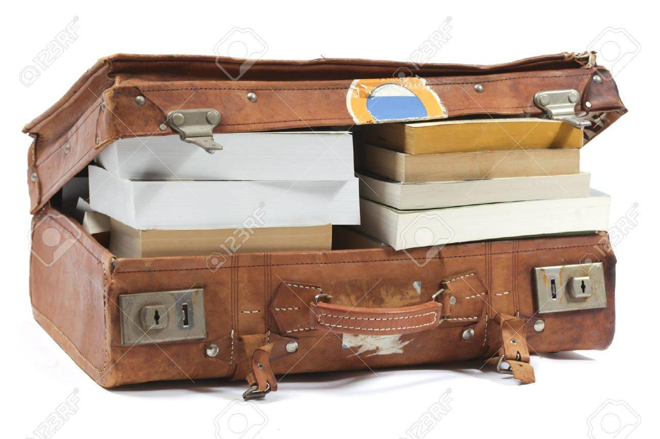 Leather suitcase filled with books Stock Photo - 9888927