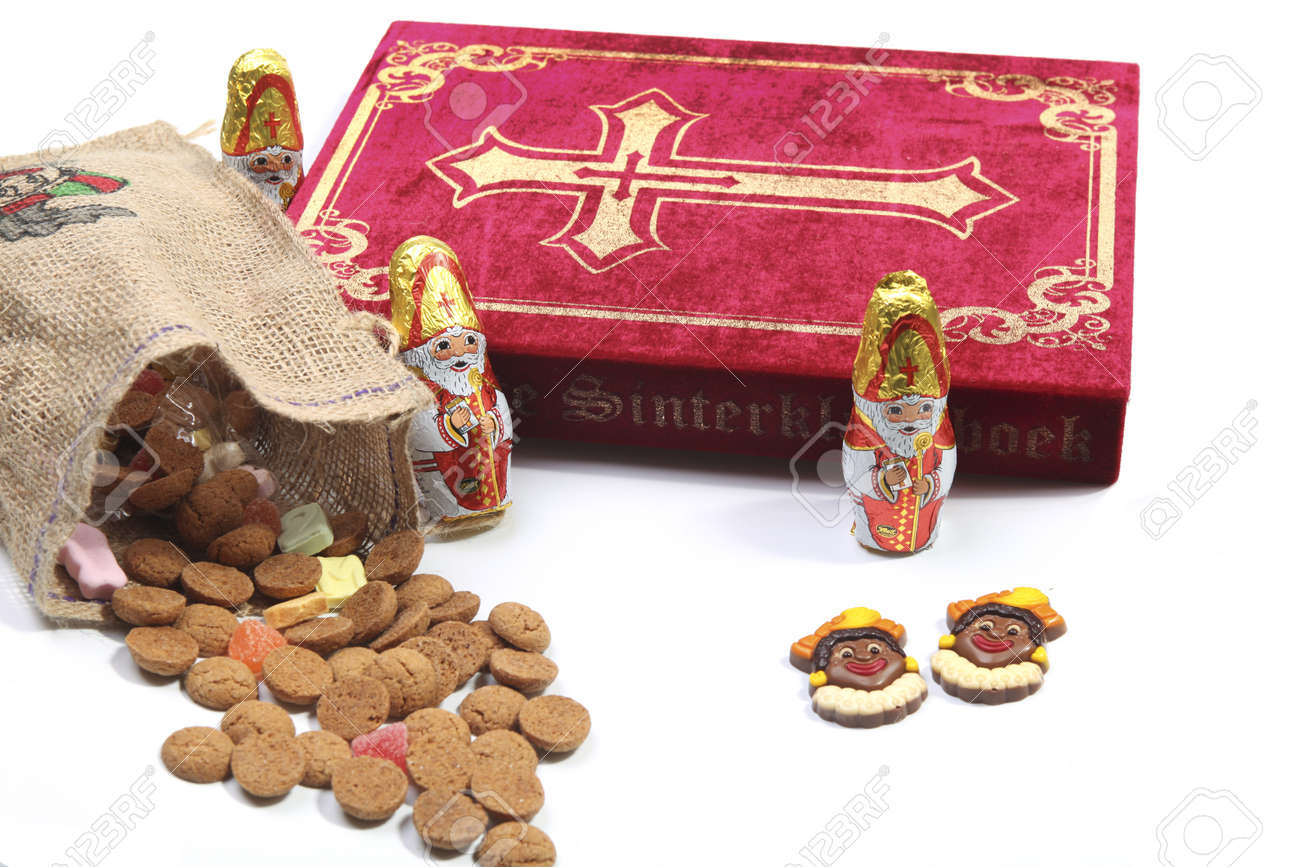 Book of Sinterklaas with candy in bag Stock Photo - 11269491