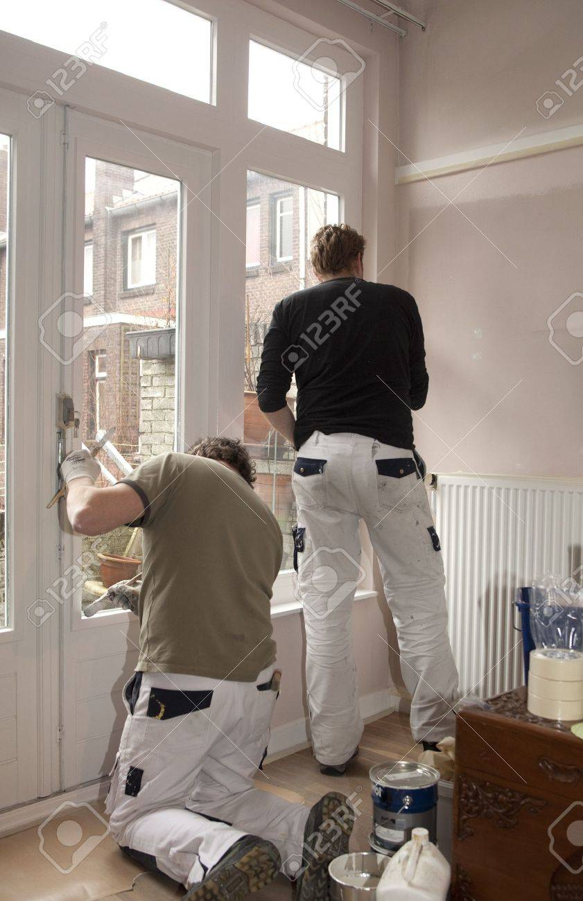 Painters at work inside a home Stock Photo - 12433618