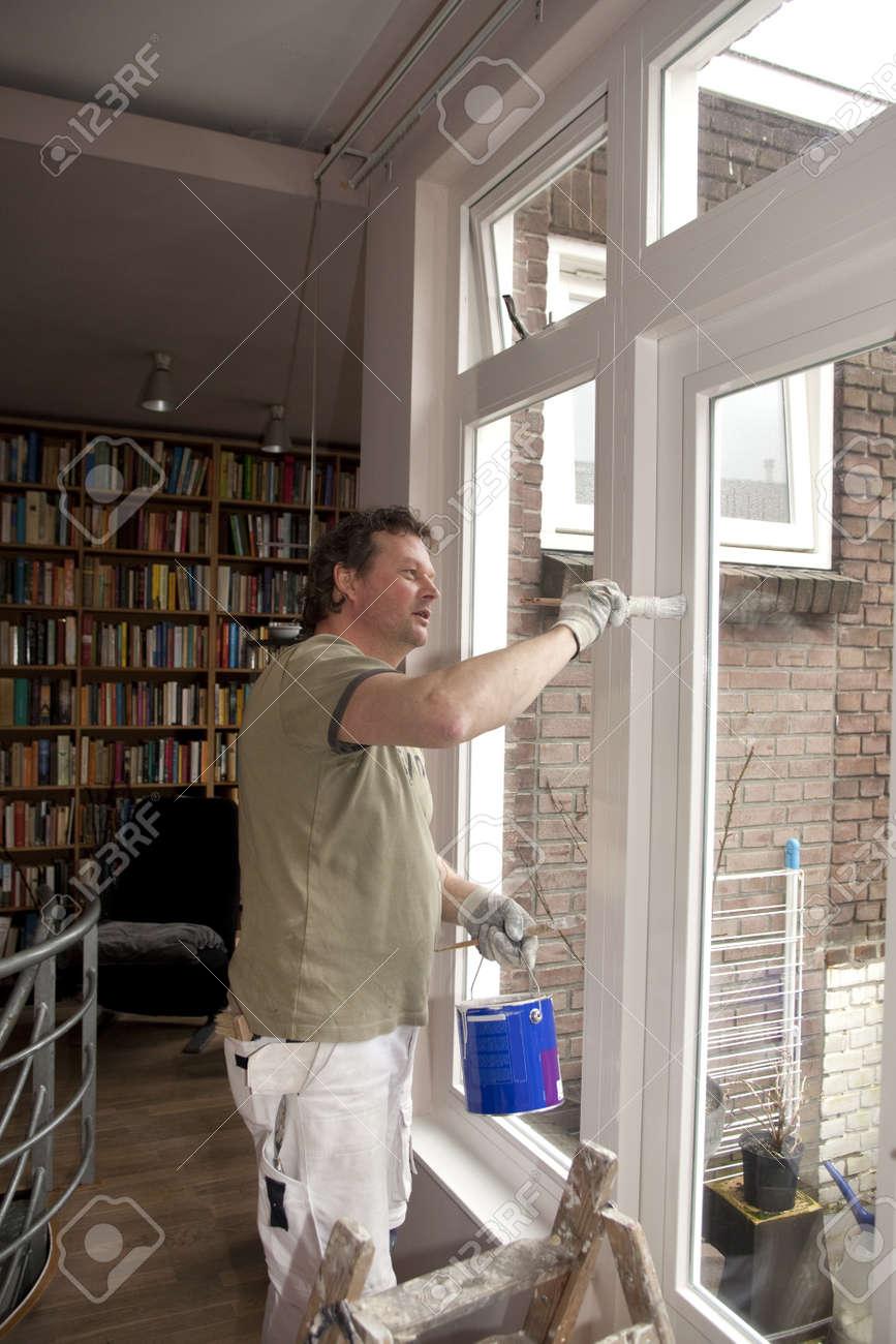 Painter painting inside of door in living room Stock Photo - 12433671 & Painter Painting Inside Of Door In Living Room Stock Photo Picture ...