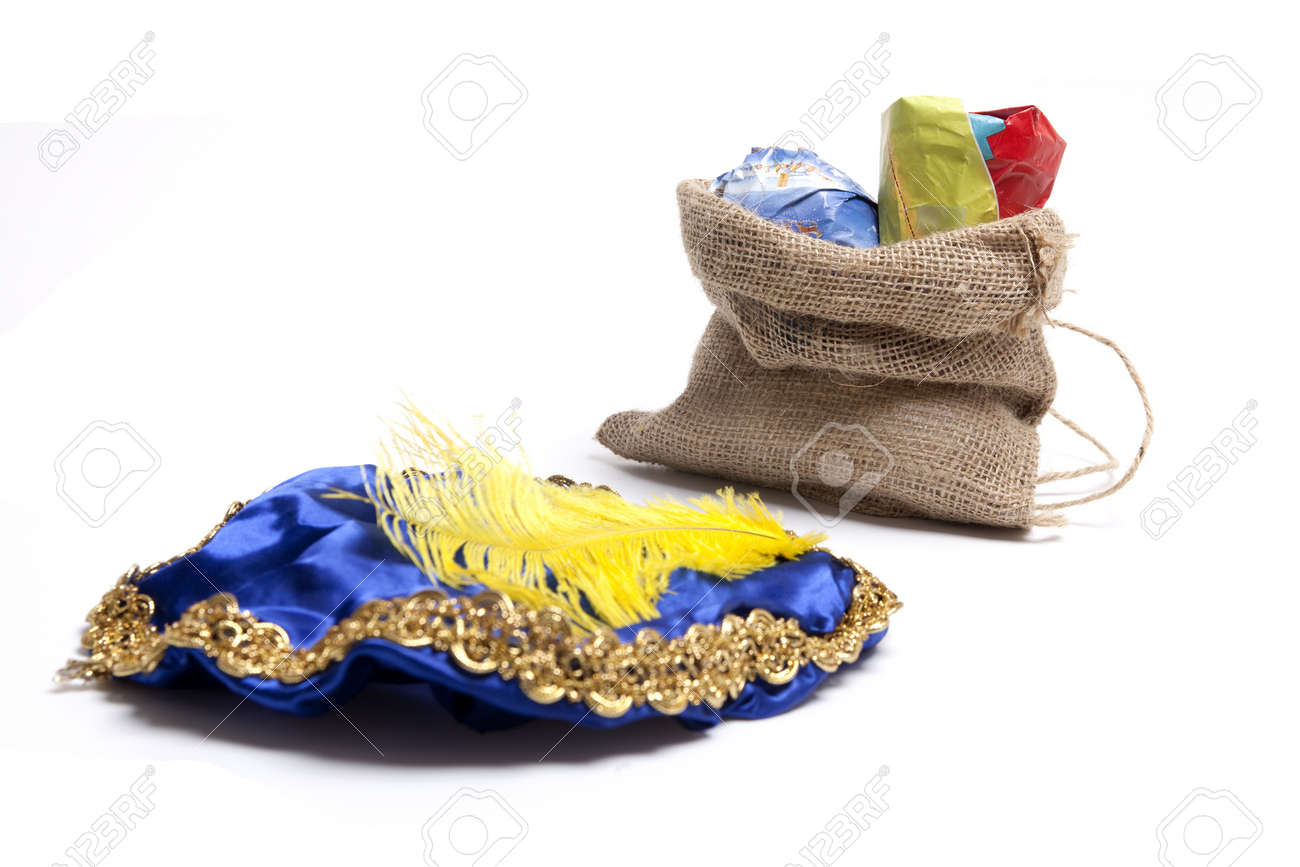 Hat of black Piet with bag filled with presents. Focus on bag Stock Photo - 15351469