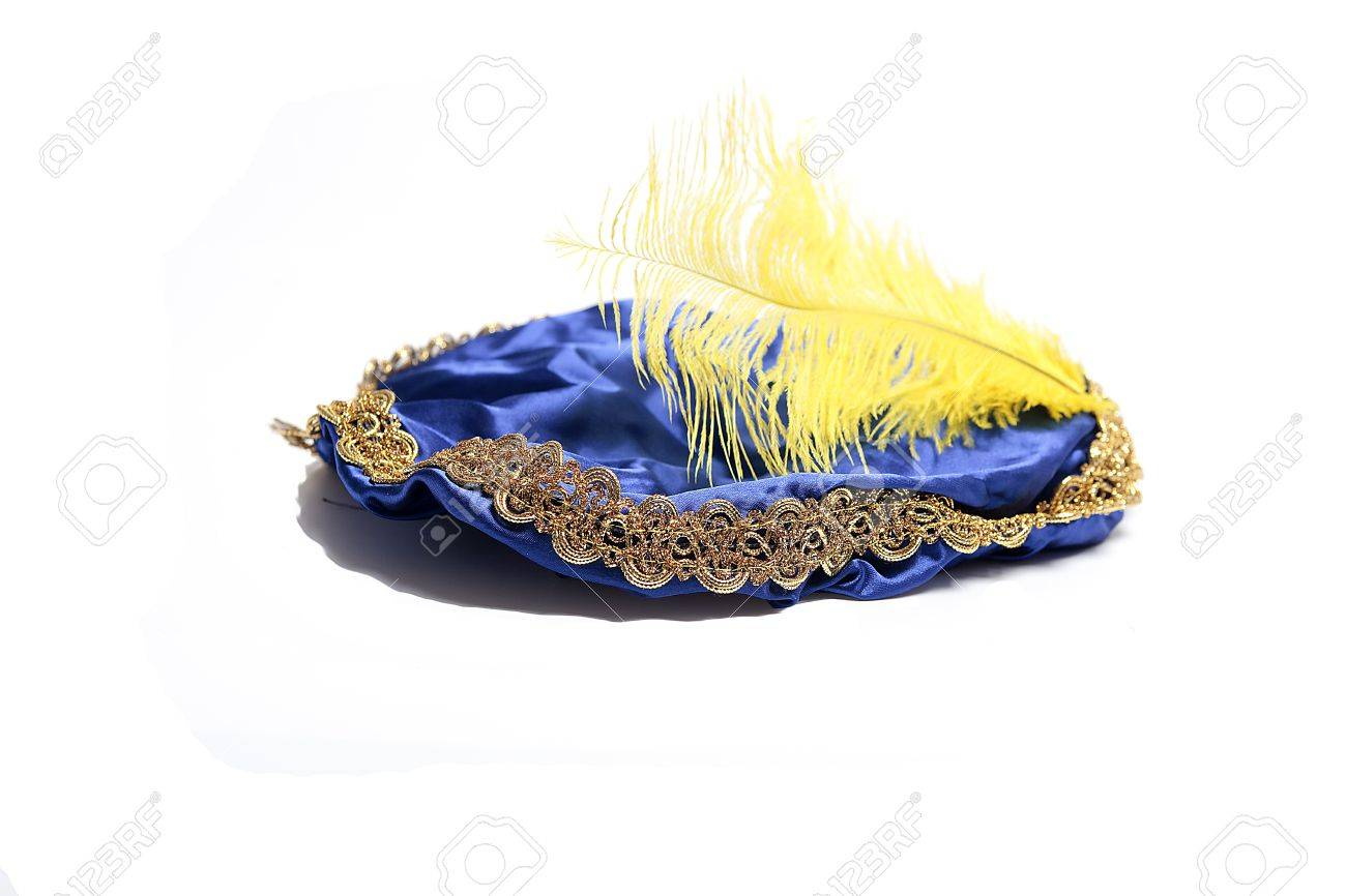 Blue hat with yellow feather of  the Dutch Black Piet Stock Photo - 15351473