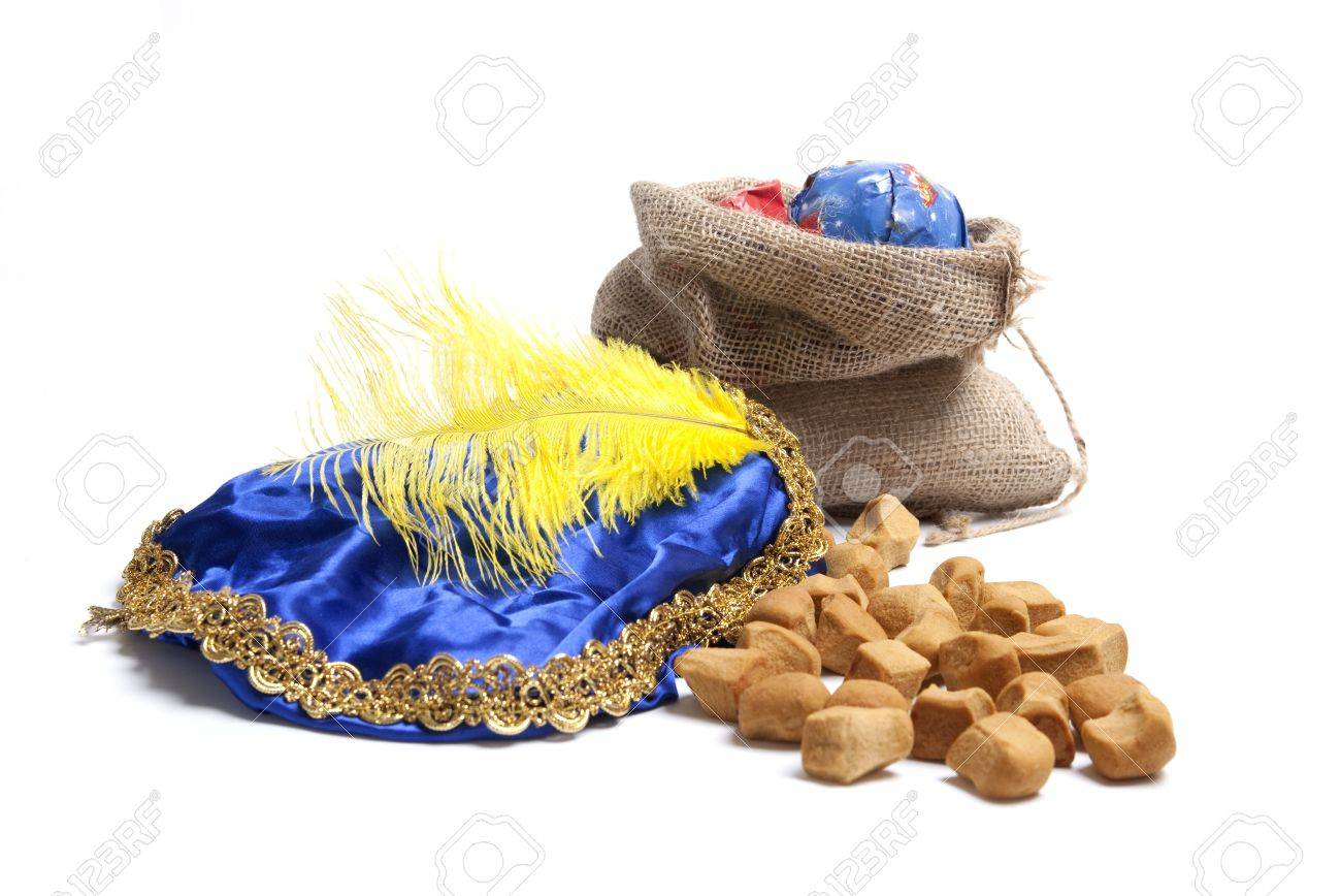 Typical Dutch celebration: Bag with presents and pepernoten, ready for the children for Sinterklaas holiday on december 5th Stock Photo - 15475094