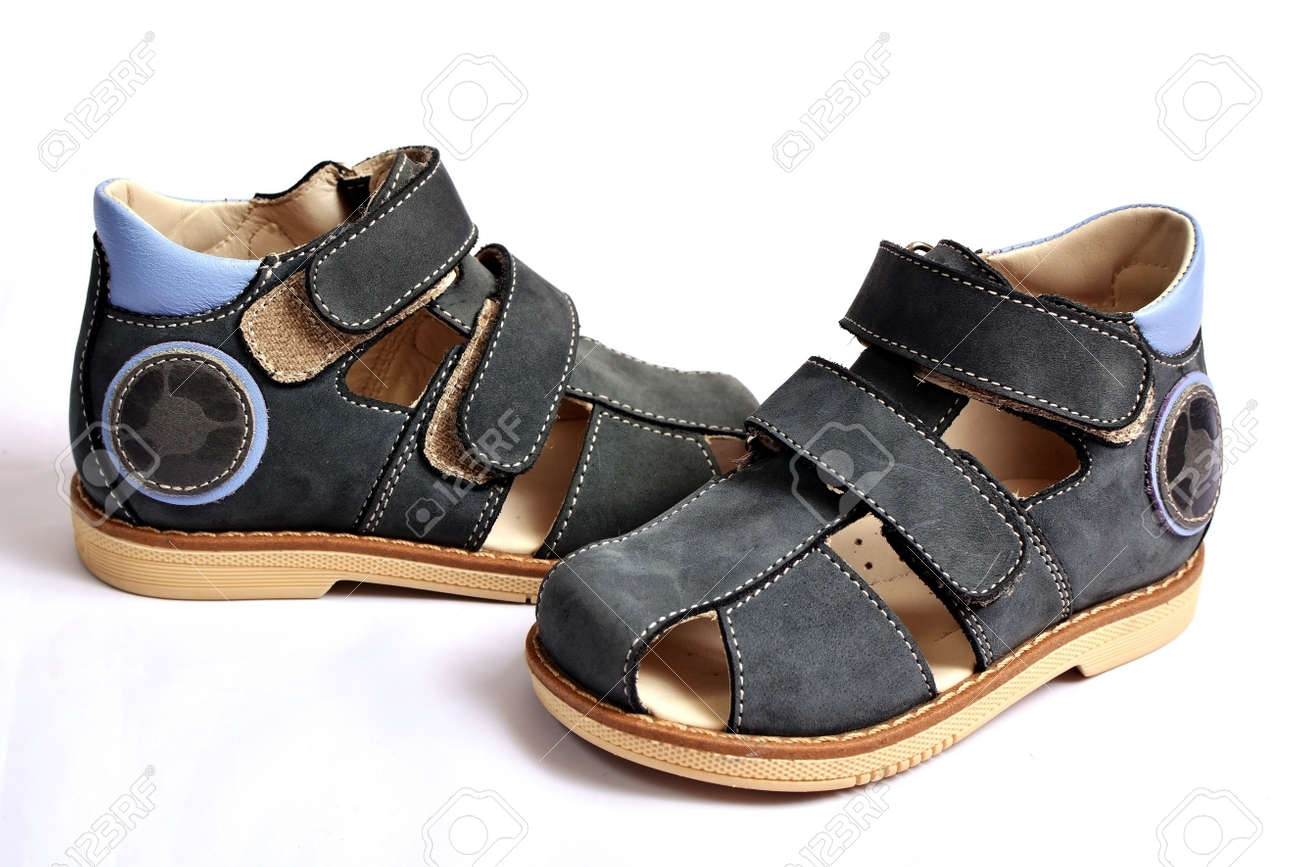 f375a03ac18c Children s sandals on a white background. Stock Photo - 60297631