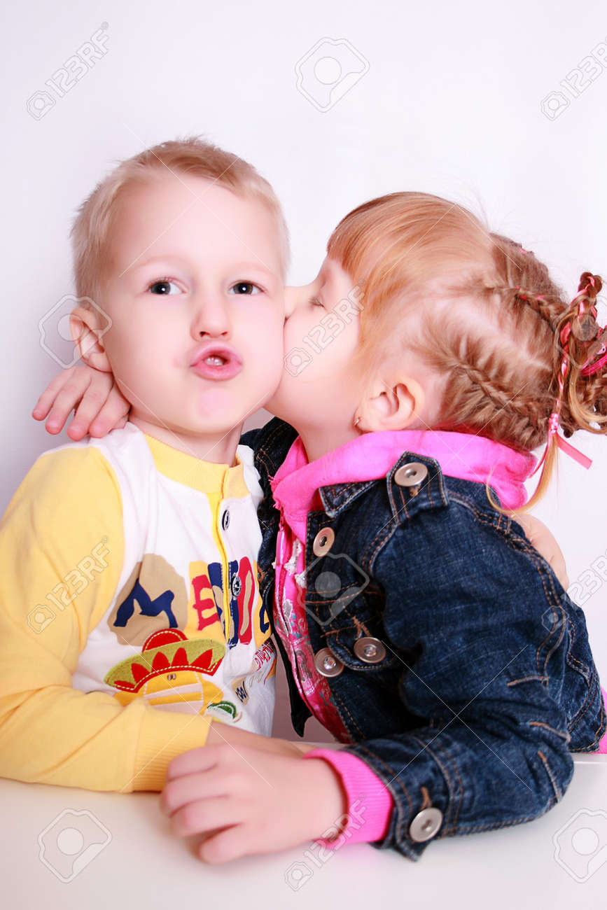 stock photo two small children in dressing gownes kiss the boy with the girl - Pics Of Small Children