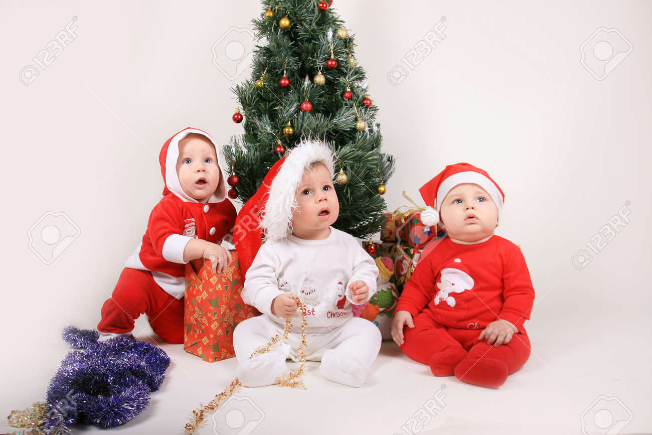 portrait of lovely babies with christmas decoration stock photo