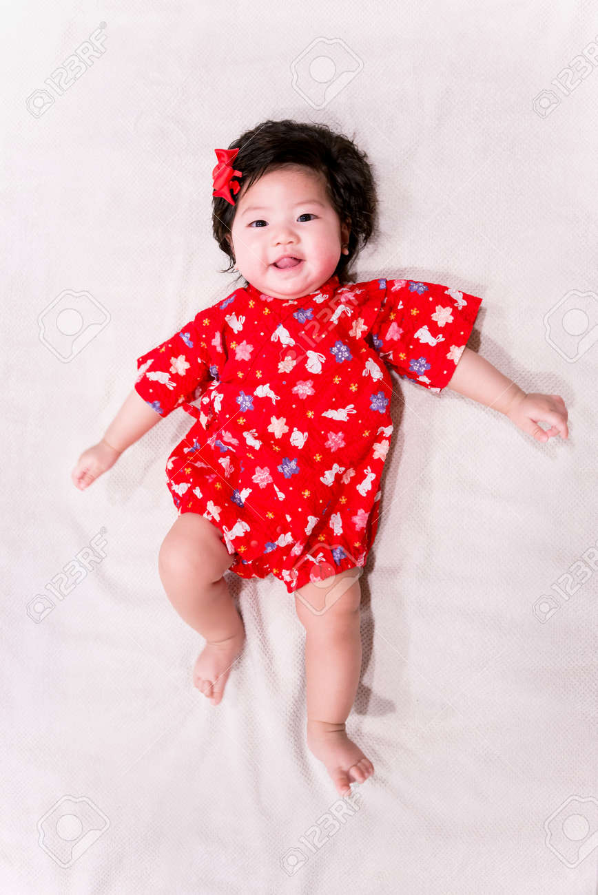 f9d88802d0f29 baby girl with cute red Japanese style outfit and white background Stock  Photo - 71323030