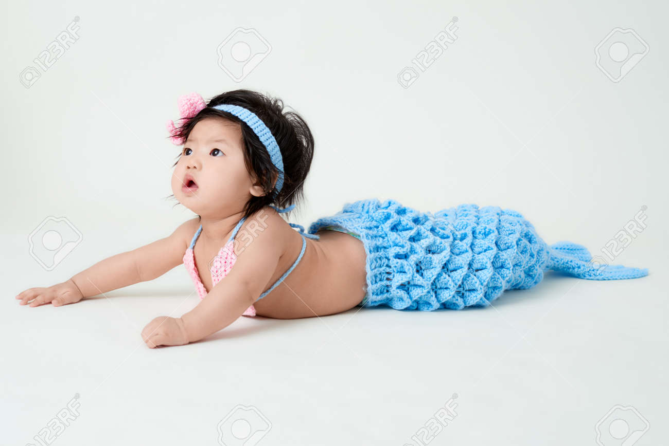 c5ec8a23b7584 baby girl with cute mermaid outfit and white background Stock Photo -  71323052