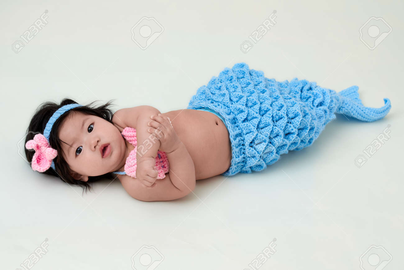 5115ecc3b702b baby girl with cute mermaid outfit and white background Stock Photo -  71323093