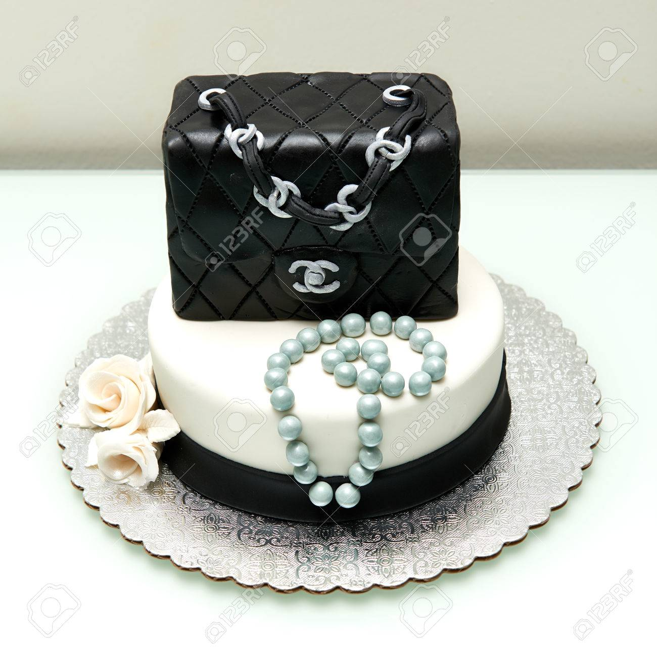 Homemade classic Chanel handbag in black fountain birthday cake. Stock  Photo - 72051262 15488f961d3cf