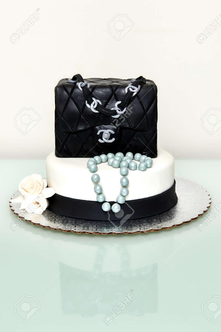 Homemade classic Chanel handbag in black fountain birthday cake. Stock  Photo - 72051321 0ce9e0fcc0a9e