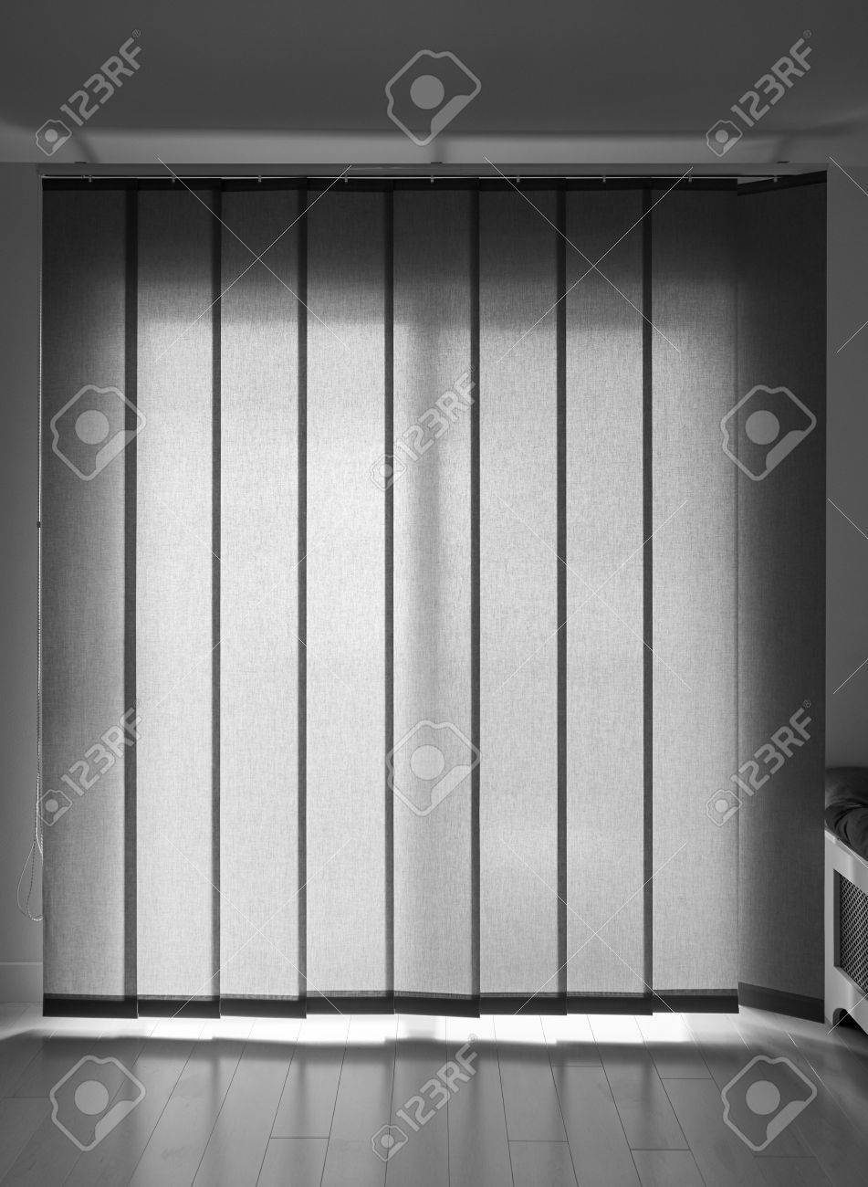 Back lit vertical patio windows blind in gray color