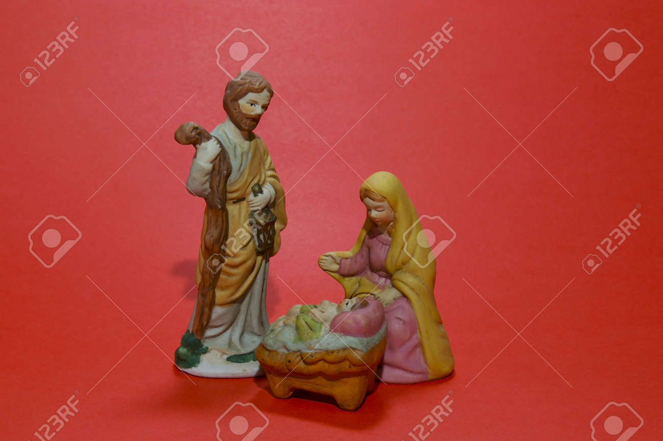 A ceramic depiction of the Nativity isolated against a red background. Stock Photo - 2174073