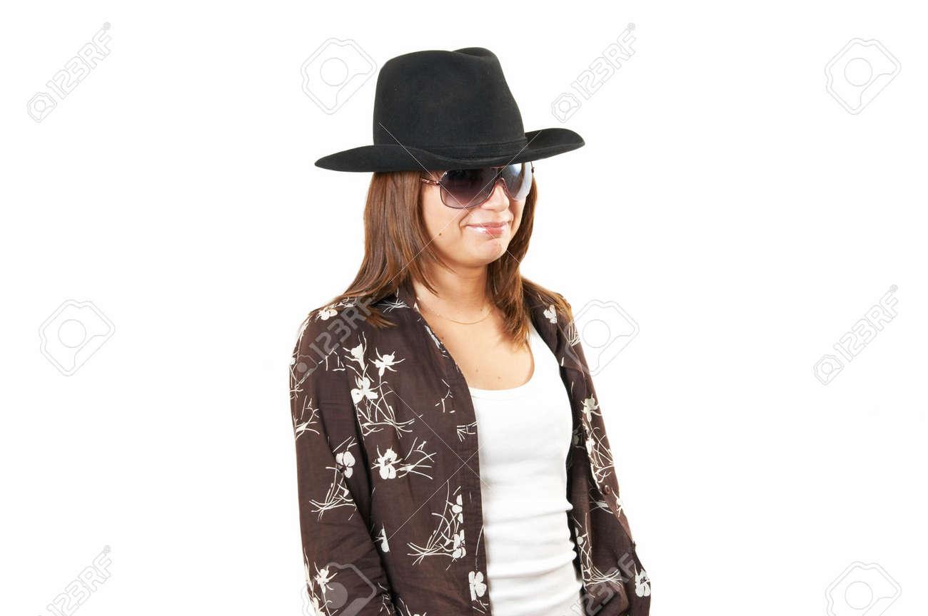 Foto de archivo - La muchacha en una chaqueta marrón y un sombrero de  vaquero 62c55f8c48d