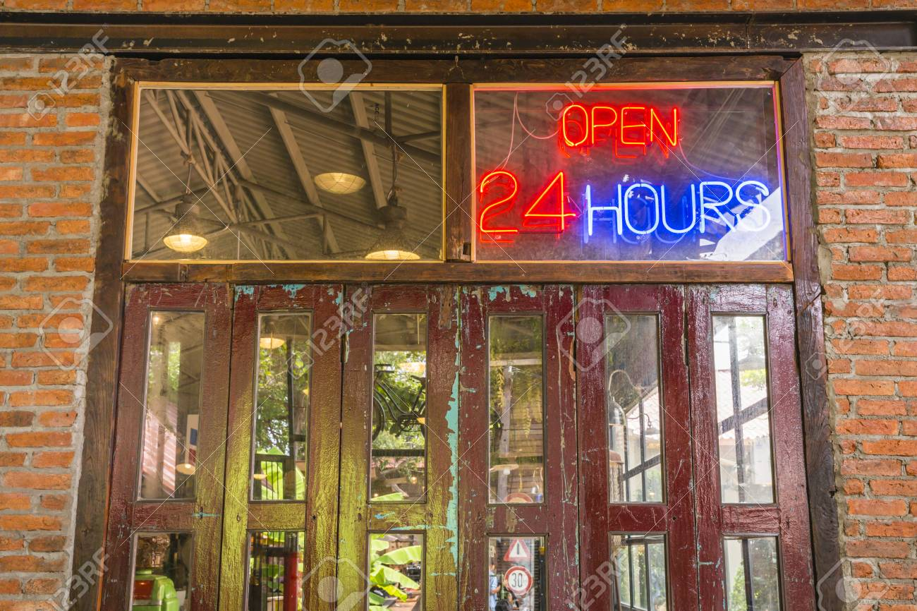 Open 24 hours sign on the old crimson door with brick wall and cement floor in & Open 24 Hours Sign On The Old Crimson Door With Brick Wall And ...